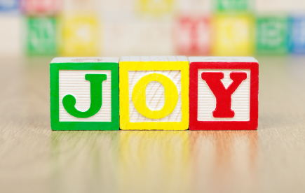JOY Spelled Out in Colorful Alphabet Building Blocks
