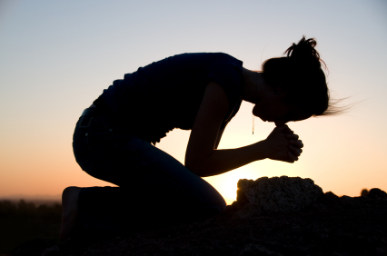 woman kneeling praying